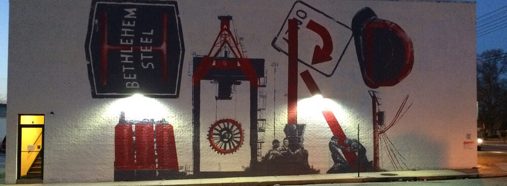 mural of steel workers and equipment