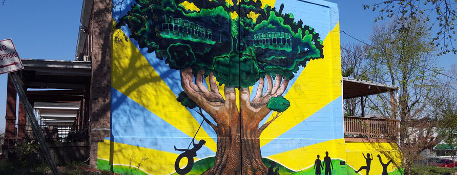 mural of hands reaching up and forming a tree